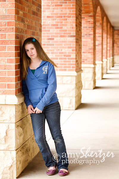 High school portrait under the arches at the Bozeman Public Library