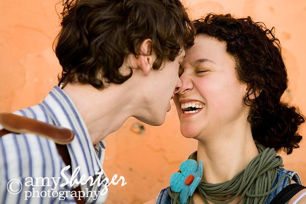 Playful couple kisses