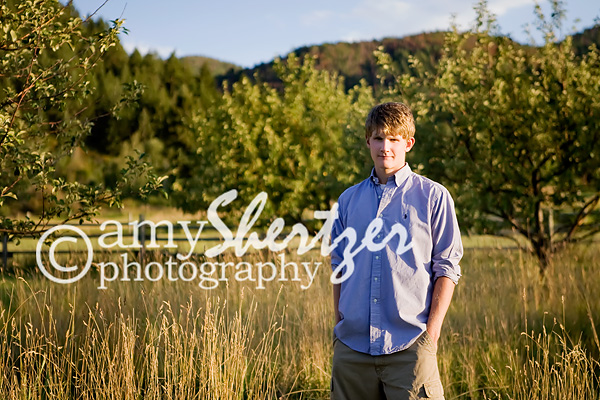 A serious look with a golden background for a senior portrait