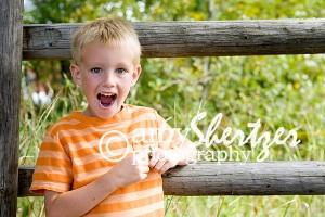 Happy boy give a big smile