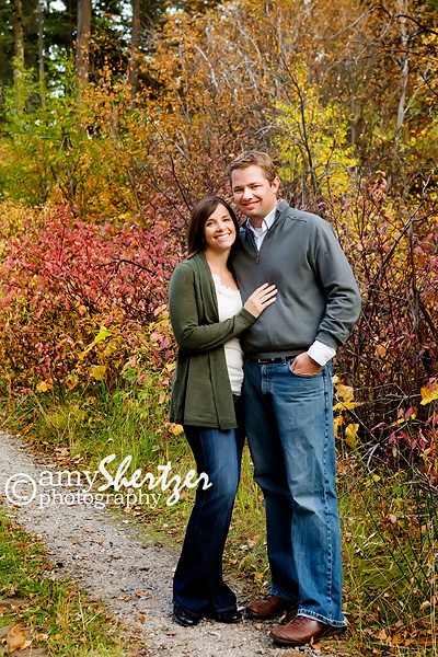 A Bozman husband and wife pose for a portrait amid the glorious fall colors.