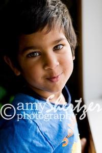 Bozeman Preschool boy smiles by the window
