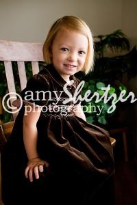 Bozeman preschool girl sits sweetly in a chair