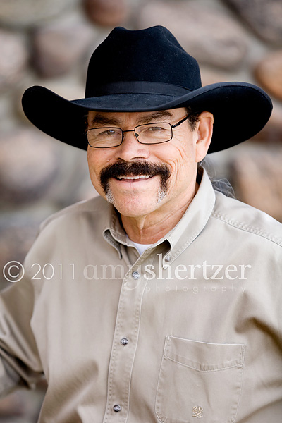 A rancher poses for a professional photo in Bozeman, MT.