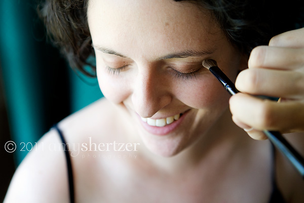 A bride has make-up applied prior to her wedding ceremony.