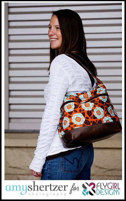 Amy Shertzer Photography photographing Fly Girl brown and orange purse.