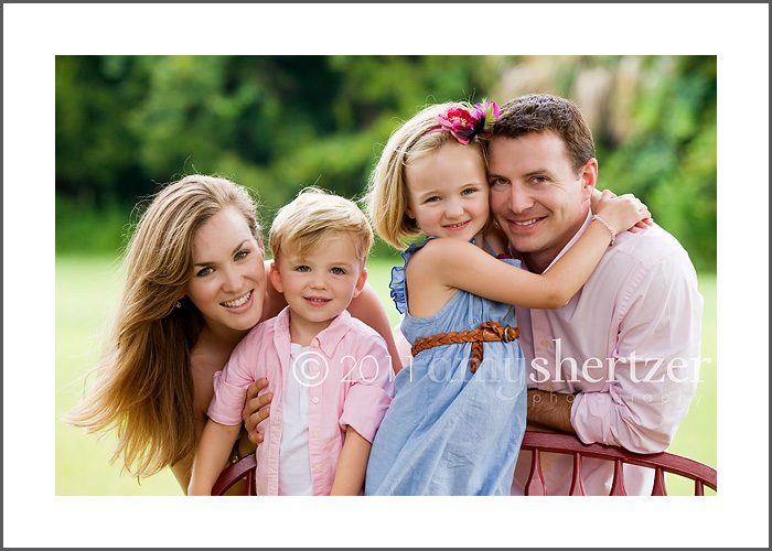 A family of 4 poses for a photo shoot for a Los Angeles-based family portrait photographer.