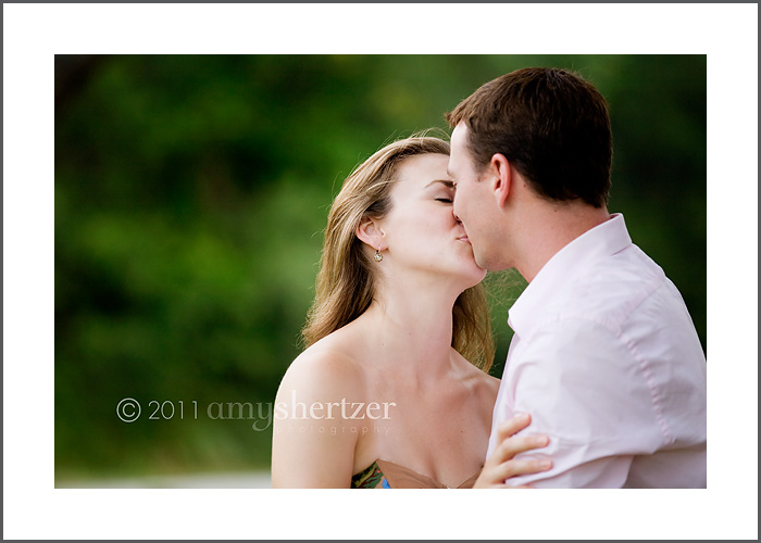 A romantic kiss between a happily wed couple.